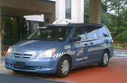 Airport taxi providing airport transfer service from a mooresville hotel.